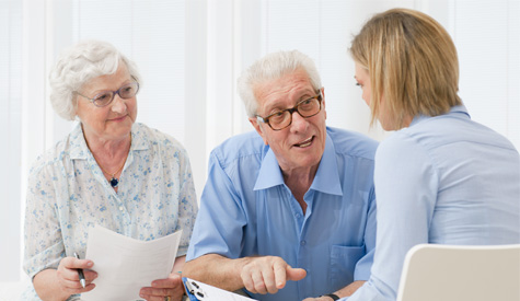 Older Couple Talking with a Realtor
